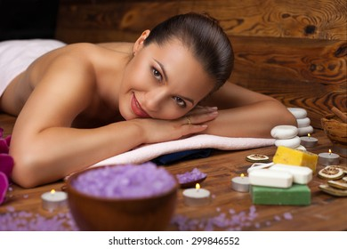 young woman on spa treatments, relaxing mind and body
