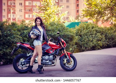 young woman on a street motorcycle in the city walls
