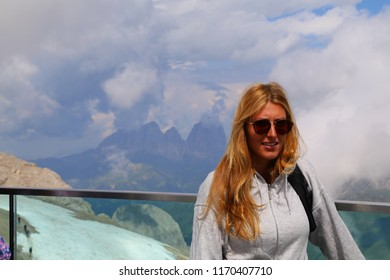 Young woman on the top of Marmolada