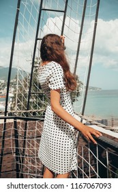 A young woman on vacation is resting in Europe. Film Vintage Modern colors. Girl in polka-dot dress. adventure at the weekend. Background for web