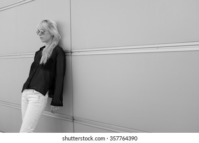Young woman on a wall - black and white photography