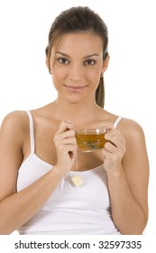 Young woman on white background with a cup of tea