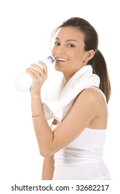 Young woman on white background in a fitness pose with water