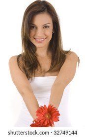 Young woman on a white background with a red gerber daisy.