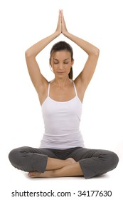 Young woman on white background in a fitness pose