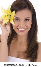 Young woman on a white background with a yellow lilly.