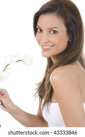 Young woman on a white background with a white orchid.