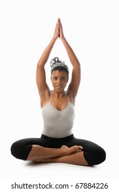 young woman on a white background doing yoga