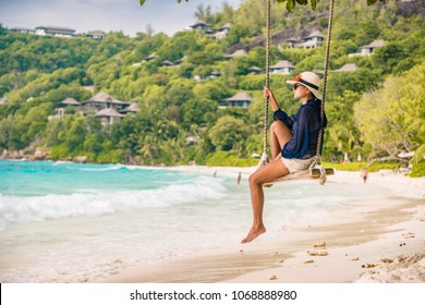 Young woman on the white beach during Holiday vacation Mahe Seychelles