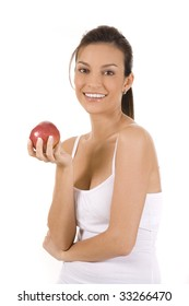 Young woman on white holding an apple.