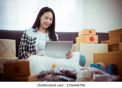 Young woman Online seller owner working for e-business commerce. Business owner checking and packing online order to delivery during sale seasonal.Online Shopping and e-Commerce concept.