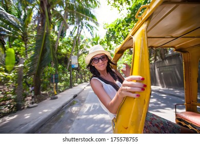 Young woman in an open cab at asian country