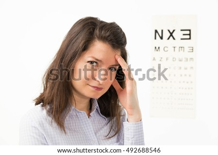 1b201c5ae2e3 Young woman at ophthalmology cabinet preparing for eye exam - isolated on  white.