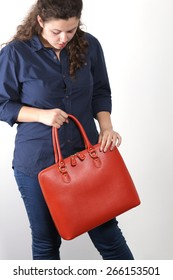 Young woman with orange genuine leather bag isolated on white background
