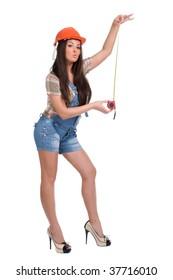 Young woman in orange helmet holding tape measure