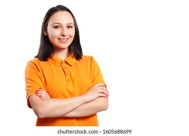 a young woman in an orange Polo shirt with her arms crossed looks at the camera and smiles. place for copy space. isolated on white background