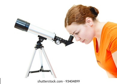 Young woman in orange t-short looking through telescope isolated on white background