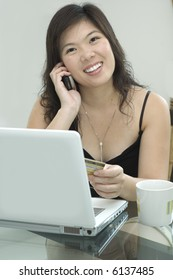 Young woman is ordering an online purchase
