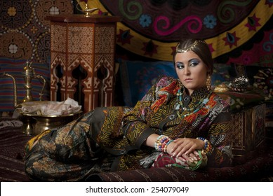 Young woman in oriental style interior and clothing