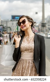 Young woman out in the city on a shopping spree
