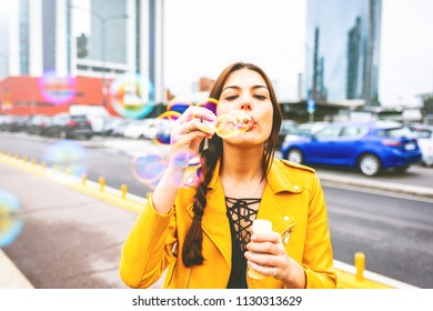 young woman outdoor playing bubble soap blowing - happiness, childhood, enjoying concept