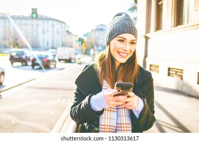 young woman outdoor using smart phone hand hold smiling - technology, happiness, social network concept