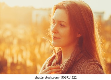 Young woman outdoors autumn sunny portrait