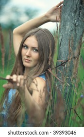 Young woman outdoors calm portrait.