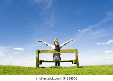 Young Woman Outdoors Celebrating Or Worshiping God