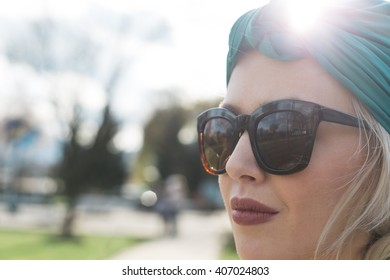 Young woman outdoors fashion portrait.