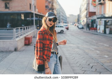 young woman outdoors posing looking away - blogger, influence, youth culture