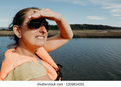 Young woman over a boat watching the horizon
