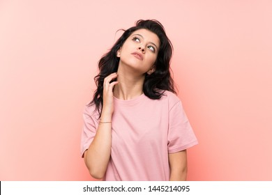 Young woman over isolated pink background thinking an idea