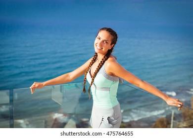 Young woman overlooking Mediterranean Sea