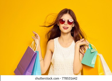 young woman with packages, purchases, discounts