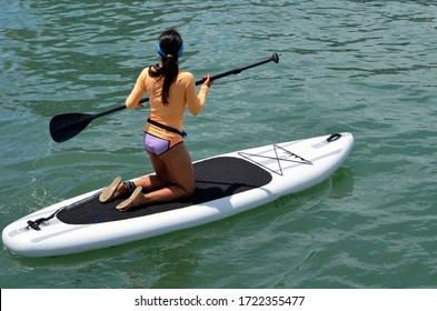 Young woman paddle boarder on biscayne bay off Miami Beach,Florida