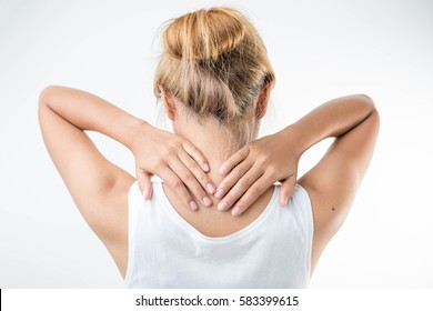 Young woman with pain in the back of her neck.,health care concept.