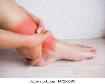 Young woman with pain in her ankle,Healthy care Concept.