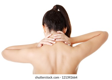 Young woman with pain in her back. Isolated on white