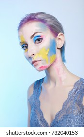 young woman with paint on her face. painted mask girl.halloween body art