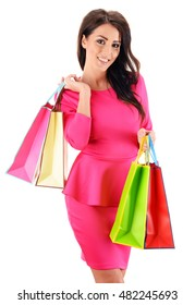 Young woman with paper shopping bags isolated on white