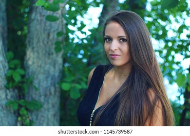 young woman in park outside during summer