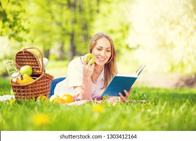 Young woman in park outside at sunny day, enjoying summertime