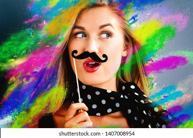 Young woman with party theme with coloful splashes