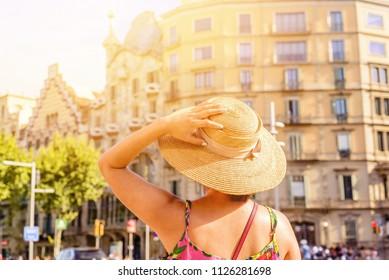 young woman in paseo de Gracia barcelona spain catalonia summer time hot sunny hat touris