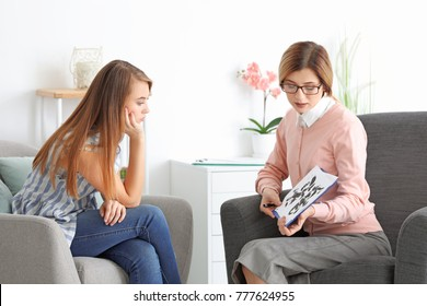 Young woman passing Rorschach test at psychologist's office