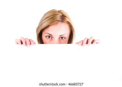 Young woman peeking from behind blank banner.