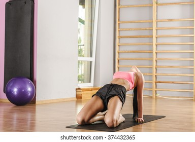 Young woman performing yoga exercises