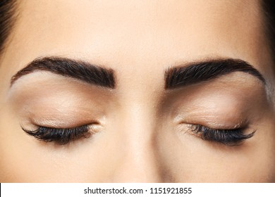 Young woman with permanent eyebrows makeup, closeup