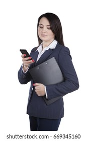 Young woman with phone in hands. While holding a resume folder in search of work. Brunette in a business suit standing in a studio on a white background